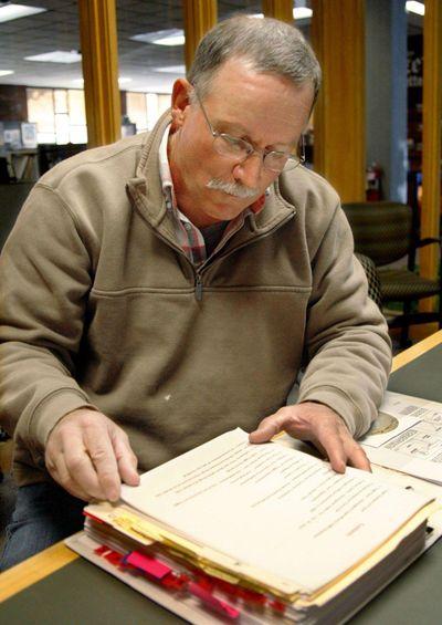 Richard Barber looks through documents on Oct. 15 that he's amassed as he has investigated Remington Arms Co. following the death of his son in 2000 from an accidental gun discharge. Photo by Brett French/Billings Gazette (Photo by Brett French/Billings G / Photo by Brett French/Billings G)