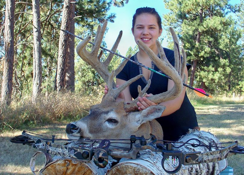 LaFawn Sutton, 12, bagged this record-book whitetail buck in velvet during the September early bowhunting season near her Mount Spokane area home.  (Jim Sutton)
