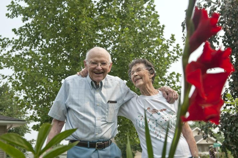 John and Amy Roberson stand near their wedding flower, the red gladiolus, in their yard in Greenacres on Wednesday, Aug. 9, 2017. The two are celebrating their 70th wedding anniversary. (Kathy Plonka / The Spokesman-Review)