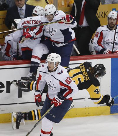 Washington Capitals' Tom Wilson (43) collides with Pittsburgh Penguins' Zach Aston-Reese (46) during the second period in Game 3 of an NHL second-round hockey playoff series in Pittsburgh, Tuesday, May 1, 2018. (Gene J. Puskar / Associated Press)