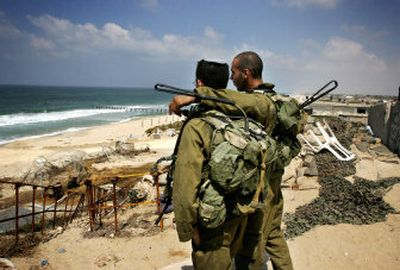 Israeli soldiers look out at the sea at a dismantled former Israeli navy base on the coast near the former Jewish settlement of Rafiah Yam in the southern Gaza Strip. Israeli troops demolished the last military installations in the Gaza Strip on Friday in final preparations to complete the pullout by Tuesday after 38 years of occupation.   (Associated Press / The Spokesman-Review)