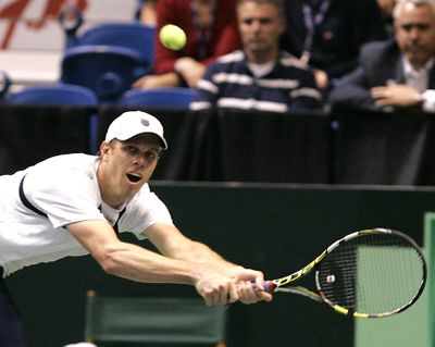 American Sam Querrey lunges to return a volley. (Associated Press)