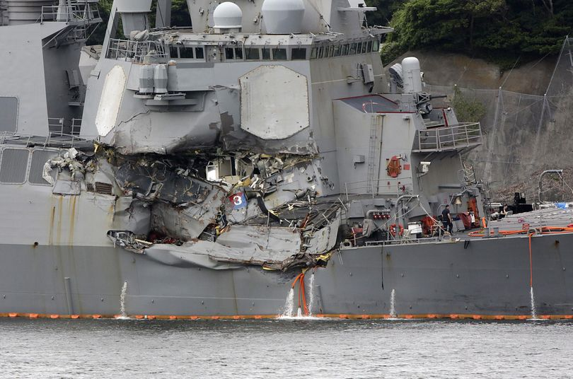 The damaged part of USS Fitzgerald is seen at the U.S. Naval base in Yokosuka, southwest of Tokyo Sunday, June 18, 2017. (Eugene Hoshiko / Associated Press)