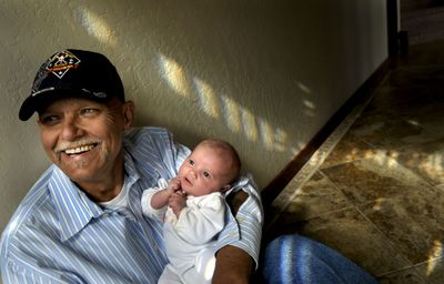 Tony Marohn holds his 1-month-old daughter, Thelia, at his home in Coeur d'Alene on  April 17. He and Brett Evans are working on a home for disabled veterans. (Kathy Plonka / The Spokesman-Review)