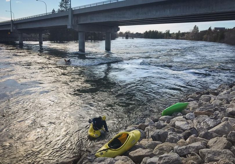 With the Spokane River at flood stage, experienced kayakers found challenging fun well within their skill level at Dead Dog Hole at the state line before local officials banned access to the river.  (Brian Jamieson)