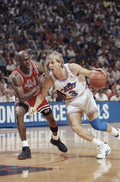 Cleveland Cavaliers guard Craig Ehlo, right, drives past Michael Jordan of the Chicago Bulls during an Eastern Conference championship game May 25, 1992, in Richfield, Ohio. (Mark Duncan / AP)