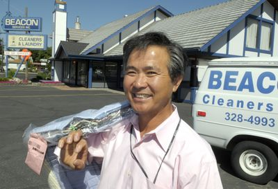 Hi Bum Kim, owner of Beacon Services Inc., stands in front of his store on Northwest Boulevard Wednesday.  (CHRISTOPHER ANDERSON / The Spokesman-Review)