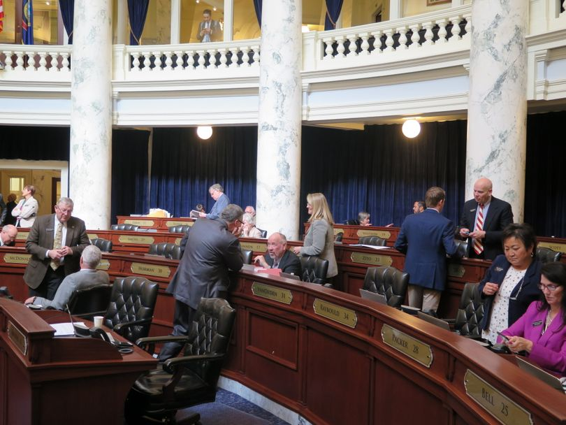 House members mill around in their chamber during an extended break, while GOP leaders met with Reps. Heather Scott, R-Blanchard, and Priscilla Giddings, R-White Bird, over their attempts to force full reading of bills in the House on Thursday. (Betsy Z. Russell)