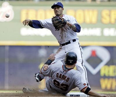 Brewers second baseman Felipe Lopez throws to first after forcing out Ryan Garko to complete a triple play. (Associated Press / The Spokesman-Review)