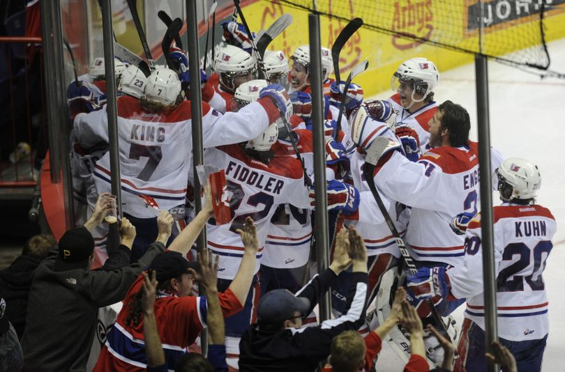 The Spokane Chiefs celebrate Friday's 3-2 overtime win over Tri-City that tied the best-of-7 series at two wins apiece. (Colin Mulvany)