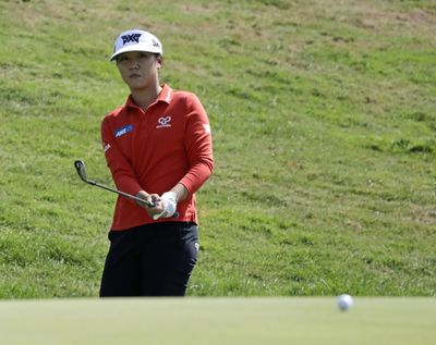 Lydia Ko, of New Zealand, chips to the eighth green of the Indy Women in Tech Championship golf tournament, Friday, Sept. 8, 2017, in Indianapolis. (Darron Cummings / Associated Press)