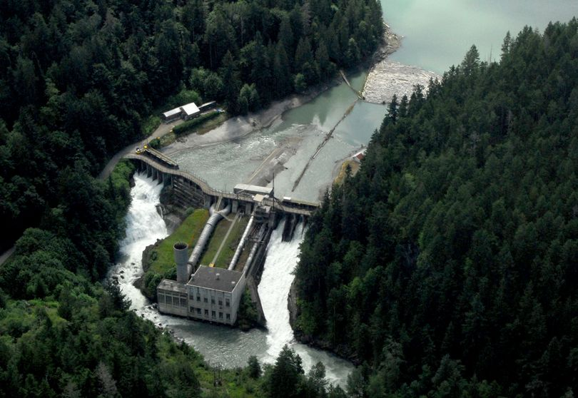 This photo taken July 29, 2011, shows an aerial view of the Elwha Dam west of Port Angeles, Wash. Dignitaries will gather at the site today to mark the beginning of the process to dismantle the dam. (Associated Press)