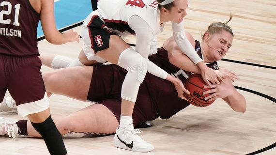 Missouri State's Emily Gartner, bottom, and Stanford's Lacie Hull battle for a loose ball in a women's NCAA Tournament Sweet 16 showdown last Sunday in San Antonio.  (SSR)