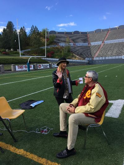 """Jerri Sher, director and producer of the documentary """"Quiet Explosions: Healing the Brain,"""" talks at Joe Albi Stadium with Mark Rypien, Super Bowl XXVI MVP, who is among the people featured in the film because of traumatic brain injury. (Courtesy)"""