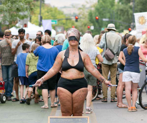 Amy Pence-Brown, a University of Idaho alumna, caused an Internet sensation when she posed blindfolded only in a bikini in a Boise public market and allowed passersby to draw hearts on her. She was promoting a positive attitude toward our bodies. (University of Idaho/courtesy photo)