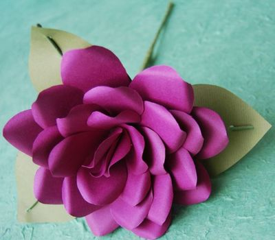 To make the petals for this rose designed by Anemone Paper Flowers, cut several teardrop shapes of varying lengths from paper, then wrap them around a wire stem using floral tape. Special to  (MEGAN COOLEY Special to / The Spokesman-Review)