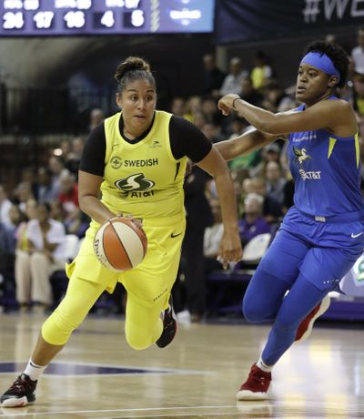Seattle Storm's Kaleena Mosqueda-Lewis, left, drives past Dallas Wings' Kaela Davis during the second half of a WNBA basketball game Friday, July 12, 2019, in Seattle. Mosqueda-Lewis led the Storm with 18 points in their 95-81 victory. (Elaine Thompson / Associated Press)