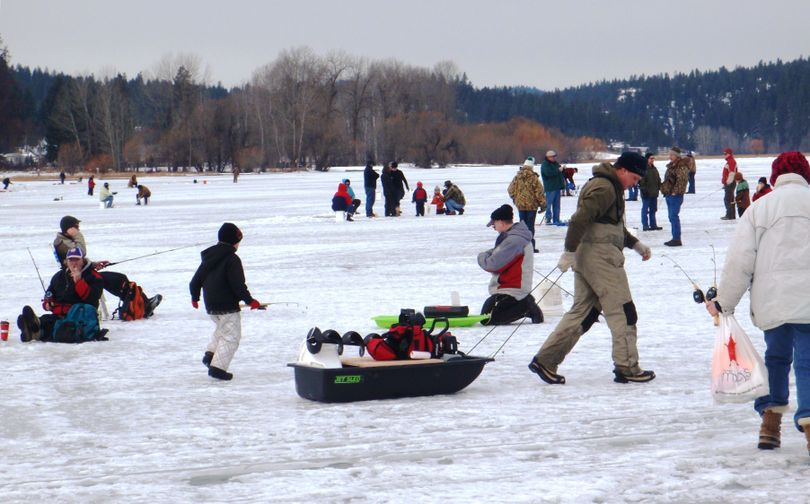 """The Idaho Fish and Game Department's """"Take Me Fishing"""" event drew a large crowd for free ice fishing at Hauser Lake on Jan. 28."""
