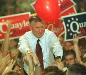 """In this April 14, 1999, file photo, Dan Quayle shakes hands with supporters in his hometown of Huntington, Ind., Wednesday, following his formal announce that he is a candidate for the Republican presidential nomination. He had learned to spell """"potato"""" by then. (AP File Photo/Chuck Robinson)"""