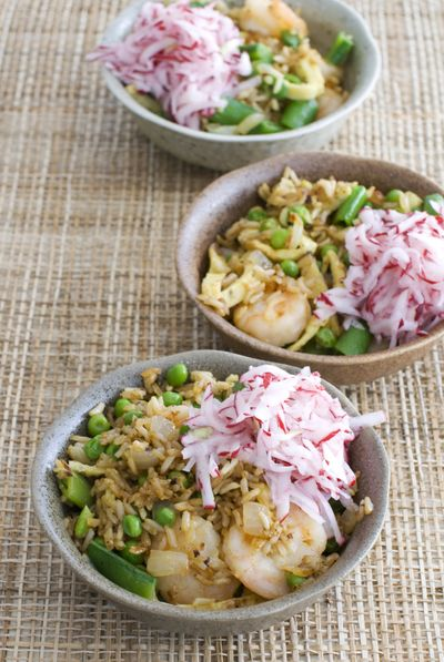 Shrimp fried rice with pickled radishes is a springtime example of the versatility of brown rice. (Associated Press)