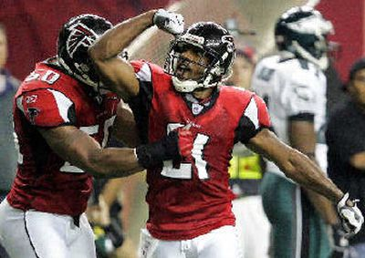 Atlanta's boosted defense includes DeAngelo Hall, right, and Edgerton Hartwell.   (Associated Press / The Spokesman-Review)
