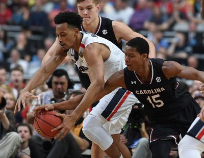 Gonzaga forward Johnathan Williams (3) and South Carolina guard PJ Dozier (15) compete for a loose ball during the second half of an NCAA Final Four basketball game, Sat., April 1, 2017, in Phoenix. (Colin Mulvany / The Spokesman-Review)