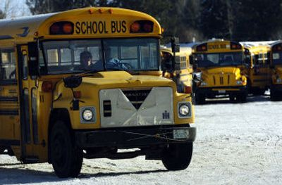 A driver steers a school bus out of the bus yard at Deer Park School District's transportation department in Deer Park.  (Holly Pickett / The Spokesman-Review)
