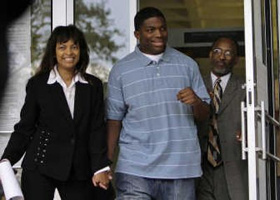 Mychal Bell, one of the Jena 6, walks with his attorneys Carol Powell Lexing and Louis Scott as they leave LaSalle Parish Courthouse in Jena, La., Thursday. Associated Press  (Associated Press / The Spokesman-Review)