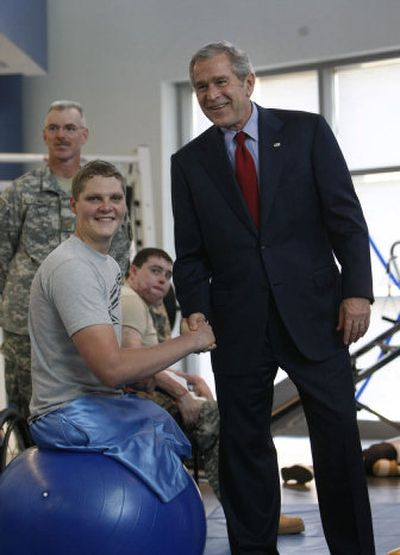 President Bush greets Army Sgt. Brandon Adam, of Sandpoint,  at a physical therapy lab for wounded soldiers at the Center for the Intrepid at the Brooke Army Medical Center in San Antonio on Nov. 8. Associated Press  (File Associated Press / The Spokesman-Review)
