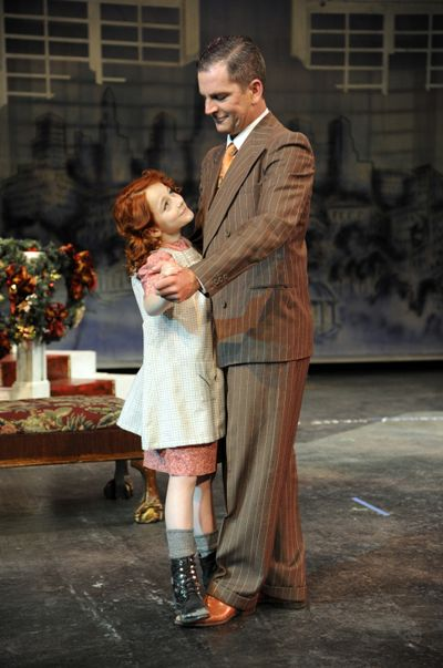 """In a scene from the Spokane Civic Theatre production of """"Annie,"""" Annie, played by Sofia Caruso, dances with Oliver """"Daddy"""" Warbucks, played by Mark Pleasant. (Colin Mulvany)"""