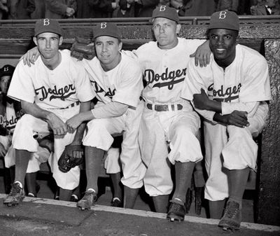 Brooklyn Dodgers players, from left,John Jorgensen, Pee Wee Reese, Ed Stanky and Jackie Robinson pose at Ebbets Field in New York on April 15, 1947. Robinson played his first major league game, for the Dodgers. He was the first black to appear in the majors since 1884.  (Associated Press)