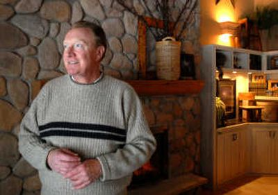 Richard Brown, former anchor at KXLY in Spokane, stands in the living room in the South Hill home he shares with his wife.   (Jesse Tinsley / The Spokesman-Review)