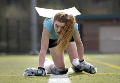Laura D'Asaro, 17, trains for her attempt to break a Guinness World Record for the fastest time to crawl a mile in Seattle  on Wednesday.  Seattle Times  (John Lok Seattle Times / The Spokesman-Review)