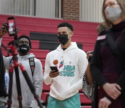 Gonzaga basketball player Jalen Suggs, center, waits for Minnehaha Academy's Chet Holmgren to announce he will play basketball at Gonzaga during a news conference Monday in Minneapolis.  (David Joles)