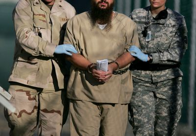 A detainee  is escorted by U.S. military personnel to an annual review board hearing  on Guantanamo Bay in 2006.  (Associated Press / The Spokesman-Review)
