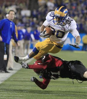 Delaware running back Andrew Pierce (30) jumps over Eastern Washington cornerback Jesse Hoffman (21) during the first half of the FCS Championship football game, Friday, Jan. 7, 2011, in Frisco, Texas. (Lm Otero / Associated Press)