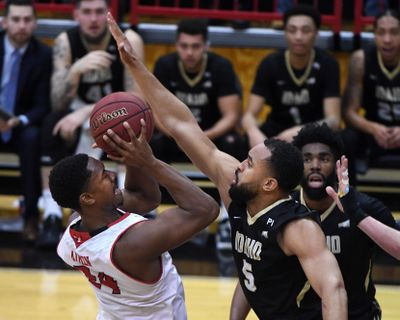 Eastern Washington forward Kim Aiken Jr.  tries to shoot past Idaho forward Quinton Forrest  during the first half Thursday, Feb. 13, 2020, in Cheney. (Colin Mulvany / The Spokesman-Review)