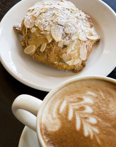 The twice-baked almond croissant goes great with a latte at Taste Café and Gourmet to Go.  (Colin Mulvany / The Spokesman-Review)