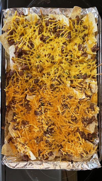 Nachos made with vegan cheese from Daiya, top, and Violife.  (Jonathan Glover/The Spokesman-Review)