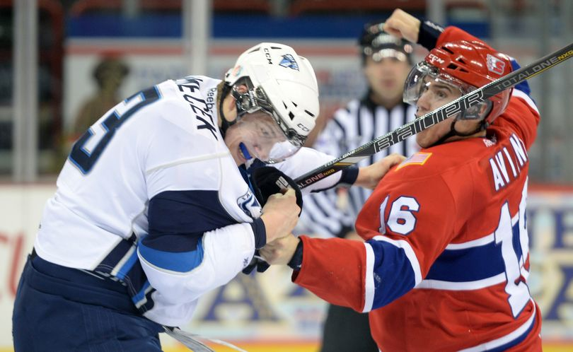 Mike Aviani, right, of the Spokane Chiefs flies into a rage and rains blows on the Saskatoon Blades' David Nemecek, left, after Nemecek cheapshotted the Chiefs' Riley Whittingham, almost knocking him unconscious in the second period Wednesday, Dec. 4, 2013 at the Spokane Arena. (Jesse Tinsley / The Spokesman-Review)