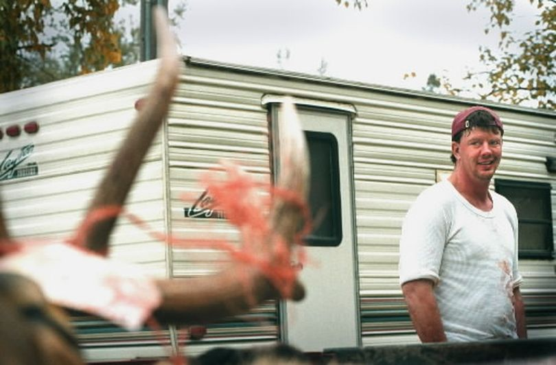Elk hunter Scott Ricks admires his 5 X 5 bull elk, in the back of his truck, at an Idaho Game and Fish check station near the North Fork of the Coeur d'Alene River in 2011.  Ricks bagged his prize shortly after 7 a.m. (FILE The Spokesman-Review)