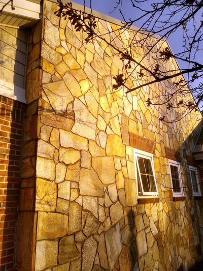 This wall is made with real stone. You can achieve a similar look using artificial stone or other non-stone products. (Tribune Content Agency)