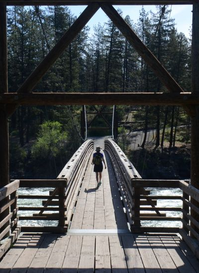 The 216-foot span over the Spokane River at the Bowl and Pitcher in Riverside State Park is the only suspension bridge in Washington's state park system.  (RICH LANDERS/FOR THE SPOKESMAN-REVIEW)