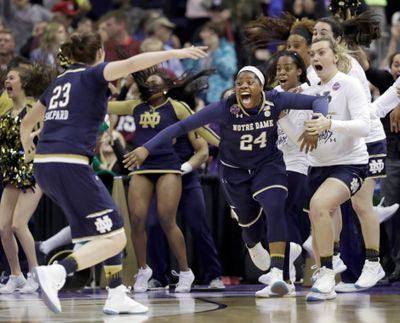 Notre Dame's Arike Ogunbowale (24) is congratulated by teammate Jessica Shepard (23) after sinking a 3-point basket to defeat Mississippi State 61-58 in the final of the women's NCAA Final Four college basketball tournament, Sunday, April 1, 2018, in Columbus, Ohio. (Tony Dejak / AP)