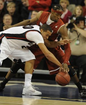 Gonzaga's Elias Harris and WSU's DeAngelo Casto chase a loose ball in the second half in McCarthey Athletic Center Wed. Dec. 2, 2009. (Colin Mulvany / The Spokesman-Review)