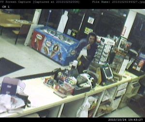 Spokane police are looking for a gunman suspected of three armed robberies in two days.