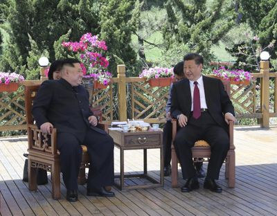 In this photo taken between May 7 and 8, 2018 released by Xinhua News Agency, Chinese President Xi Jinping, right speaks to North Korean leader Kim Jong Un in Dalian in northeastern China's Liaoning Province. (Ju Peng / Associated Press)