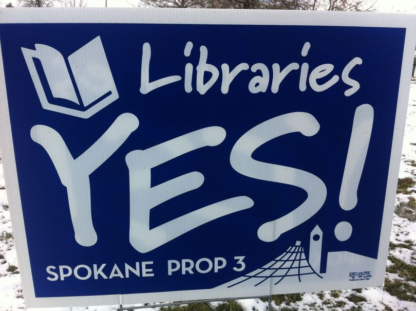 Yes for Spokane Libraries has paid for these signs in support of Proposition 3, a library lid lift that would prevent branch closures and likely extend hours at three of the city's six branches. (Jonathan Brunt)