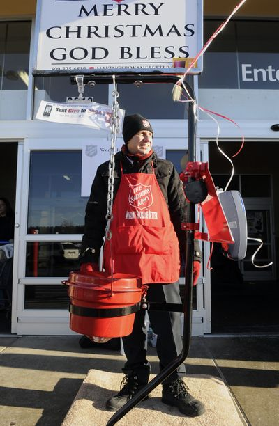 Captain Kyle Smith, of the Salvation Army, mans his post outside the Northpoint Walmart, Dec. 17,  in Spokane. Smith was trying to break the record for continuous bell ringing. He was hoping to stay for 32 hours – and did. (Dan Pelle)