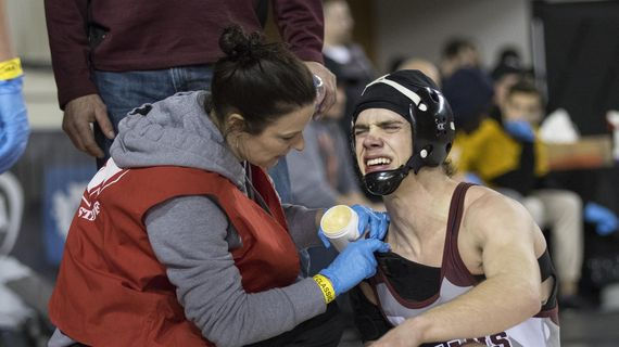 Colville's Reuben Seeman, right, was winning his match with Sultan's Aidan Fleming until he reinjured his shoulder late in the third period during their 132-pound match at State 1A wrestling in Tacoma on Friday, Feb. 21, 2020. (Patrick Hagerty / For The Spokesman-Review)